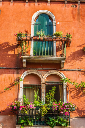 the merchant of venice: Building with traditional Venetian windows in Venice, Italy Stock Photo