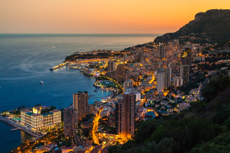 Monte Carlo in View of Monaco at night on the Cote dAzur photo