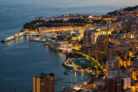 Monte Carlo in View of Monaco at night on the Cote dAzur photo