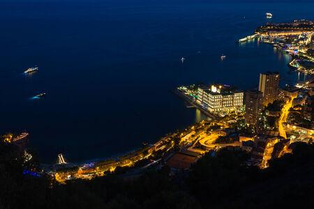 d'azur: Monte Carlo in View of Monaco at night on the Cote dAzur Stock Photo