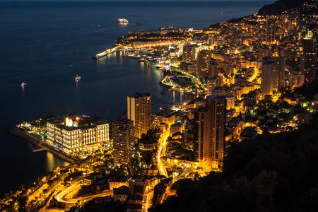 Monte Carlo in View of Monaco at night on the Cote dAzur Stock Photo