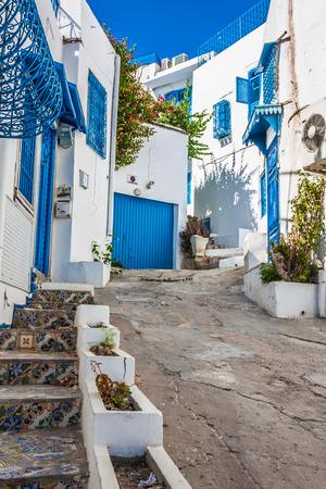 sidi bou said: Sidi Bou Said - typical building with white walls, blue doors and windows, Tunisia Editorial