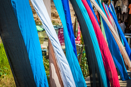 haggling: Colorful fabrics for sale in Chebika,Tunisia Stock Photo