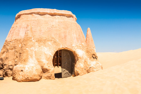 troglodyte: Buildings in Ong Jemel, Tunisia. Ong Jemel is a place near Tozeur, where the movies Star wars Stock Photo