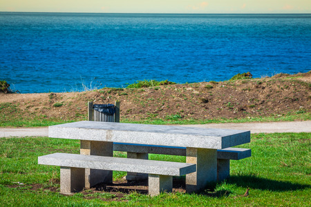 Secluded place for meditations on the sea shore. On a bench photo