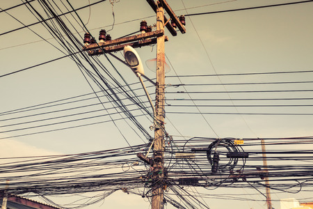 electrics: bunch of electrics and communication wires in Phuket street, Thailand