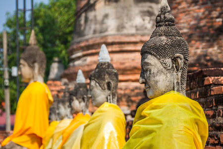Buddha statues in Ayutthaya,Thailand. In 1767, the city was destroyed by the Burmese army. The ruins are preserved in Ayutthaya historical park, which is recognized as a UNESCO World Heritage Site.