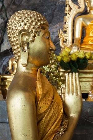 Buddha statues on the tiger cave temple near krabi ,thailand photo