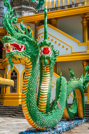 stair well: Green naka statue in front of Thai Buddhist pagoda at Tiger Cave Temple , Krabi , South of Thailand.