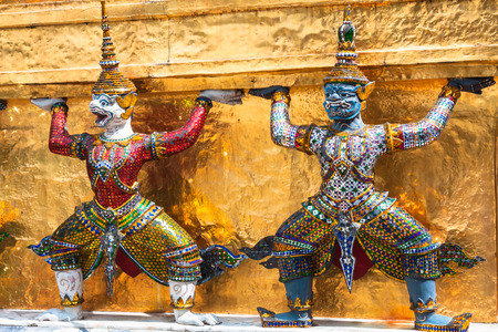 Guards on the base level of stupa in Wat Phra Keo, Thailand photo