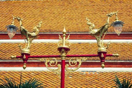 Thai traditional beautiful golden swan on street lamp post in Bangkok, Thailand. photo