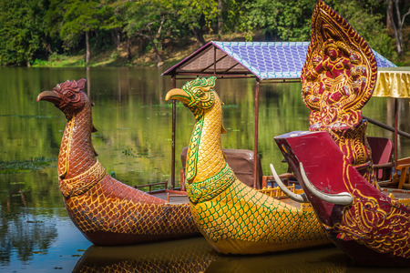 Thai traditional  boats on the lake near,Bayon temple in Angkor Thom, Siemreap, Cambodia. photo
