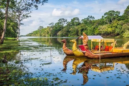 angkor thom: Thai traditional  boats on the lake near,Bayon temple in Angkor Thom, Siemreap, Cambodia.