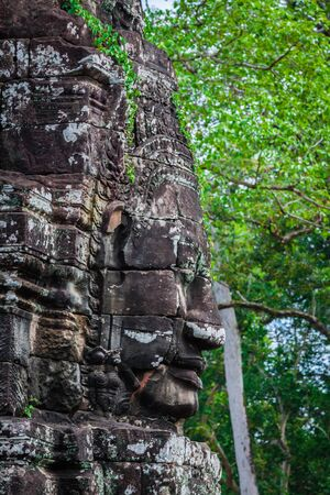 thom: Faces of Bayon temple in Angkor Thom, Siemreap, Cambodia.