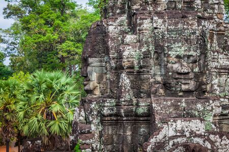 thom: Ancient stone faces of Bayon temple, Angkor, Cambodia