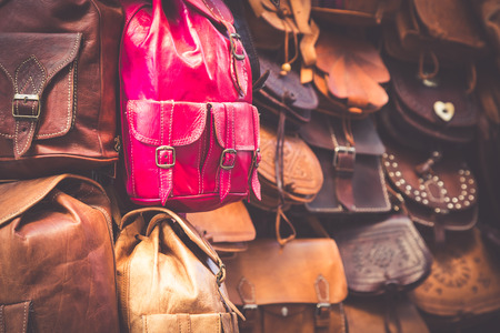 Moroccan leather goods bags in a row at outdoor market Stock Photo