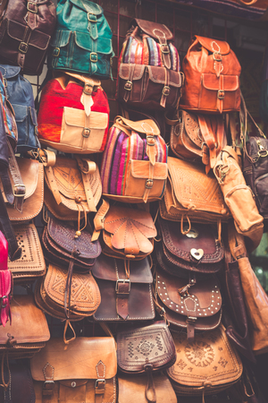 gift bags: Moroccan leather goods bags in a row at outdoor market Stock Photo
