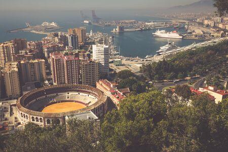 bullring: View of Malaga with bullring and harbor. Spain Stock Photo