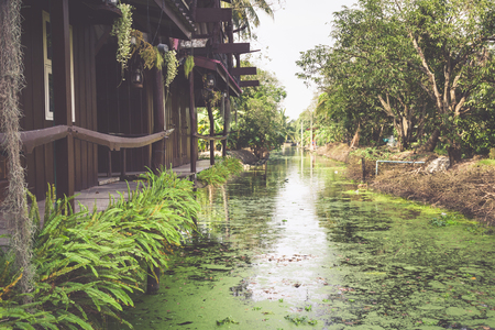 house float on water: Wooden houses along the canals river, Thailand Stock Photo