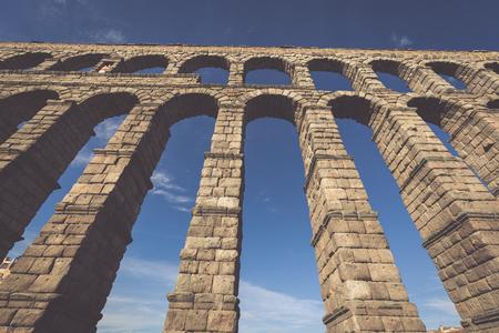 acueducto: The famous ancient aqueduct in Segovia, Castilla y Leon, Spain Stock Photo