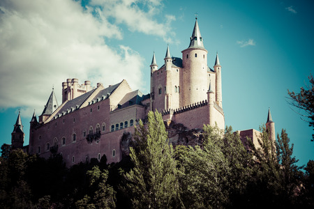 castile leon: Segovia, Spain. The famous Alcazar of Segovia, rising out on a rocky crag, built in 1120. Castilla y Leon.