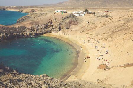 sun bathers: Papagayo beach, Lanzarote. Canary Island.