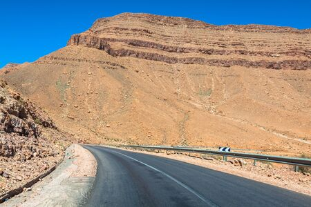 endless road: Endless road in Sahara Desert with blue sky,Morocco Africa