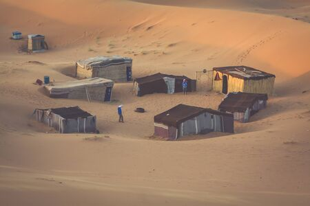 erg: Tent camp for tourists in sand dunes of Erg Chebbi at dawn, Morocco