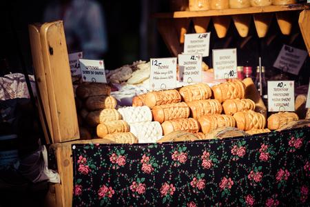 oscypek: Traditional polish smoked cheese oscypek on outdoor market in Zakopane