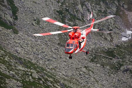 airscrew: Zakopane,Poland-July 4,2015:Helicopter mountain rescue service in the High Tatras.