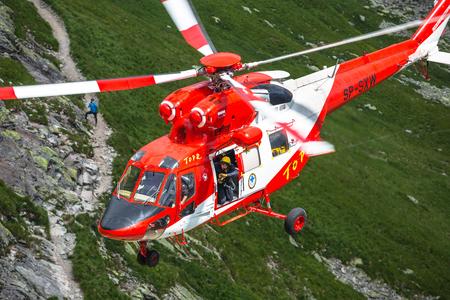 rescue service: Zakopane,Poland-July 4,2015:Helicopter mountain rescue service in the High Tatras.