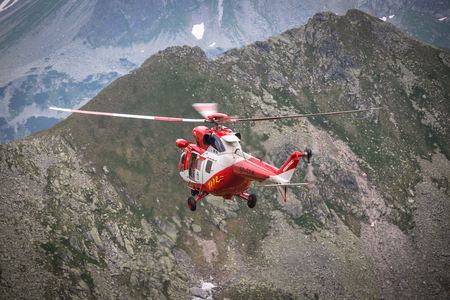 scrambling: Zakopane,Poland-July 4,2015:Helicopter mountain rescue service in the High Tatras.
