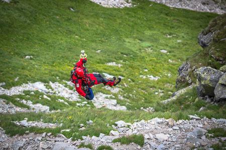 karabiner: Zakopane,Poland-July 4,2015:A mountain rescue team prepares for a helicopter rescue.