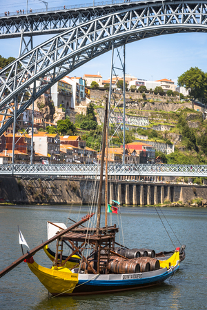 rabelo: Porto, Portugal -21 May 2015:Porto, Portugal old town cityscape on the Douro River with traditional Rabelo boats.