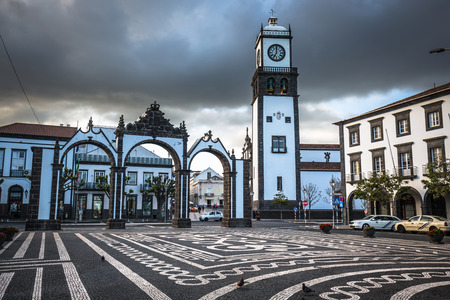 urbanized: Ponta Delgada, Azores, Portugal - April 20, 2015: Portas da Cidade (Gates to the City) - historic entrance to the town of Ponta Delgada on Sao Miguel island, Azores