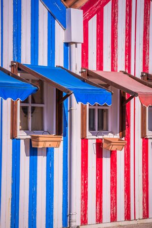 fishermen's: Colorful striped fishermens houses in blue and red, Costa Nova, Aveiro, Portugal