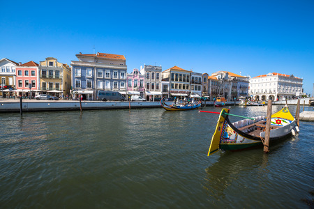 city park boat house: Aveiro, Portugal - 22 May,2015: Moliceiro boats sail along the central canal