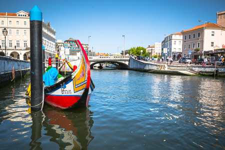 Aveiro, Portugal - 22 May,2015: Moliceiro boats sail along the central canal