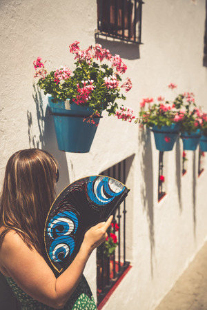 spanish woman: Young spanish woman with fan.