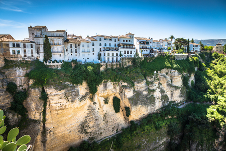 ronda: view of buildings over cliff in ronda, spain