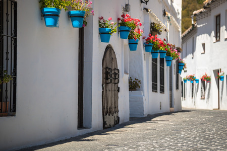 Street with flowers in the Mijas town, Spain Stock Photo