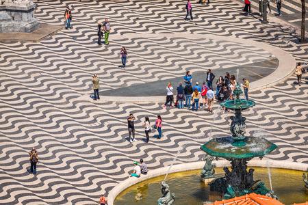baixa: Lisbon, Portugal-April 12,2015: cityscape at Rossio Square. Editorial
