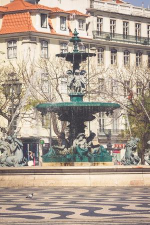 baixa: Lisbon,Portugal-April 12,2015:Rossio square with fountain located at Baixa district in Lisbon, Portugal