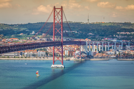 salazar: Lisbon,Portugal-April 11,2015:The 25 de Abril Bridge is a bridge connecting the city of Lisbon to the municipality of Almada on the left bank of the Tejo river, Lisbon