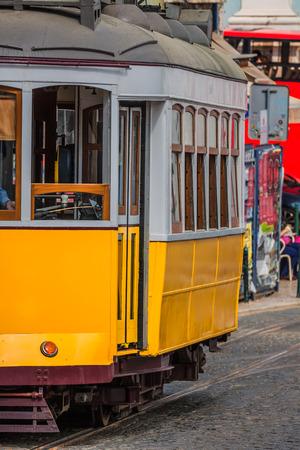 tramway: Romantic yellow tramway - main symbol of Lisbon, Portugal