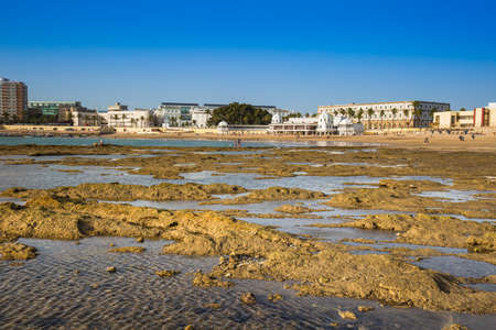 bathhouse: Old bathhouse on the beach of La Caleta, one of the most famous sites in the city of Cadiz, Spain Stock Photo