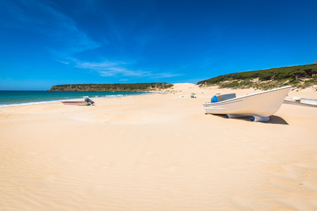 boat at bolonia beach a coastal village in the municipality of Tarifa in the Province of Cadiz in southern Spain.