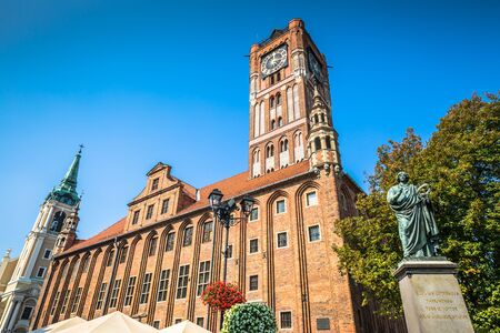 Town hall and Copernicus monument in Torun old town Poland
