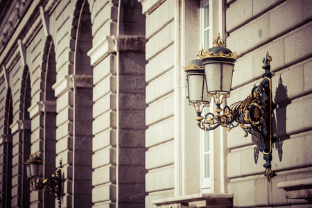 Elegant city lantern near royal palace in Madrid Stock Photo