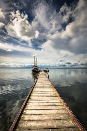 wooden pier in the sunset Stock Photo